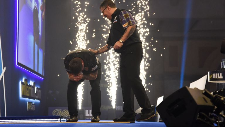 Gary Anderson congratulates Gerwyn Price after the Welsman became world champion for the first time