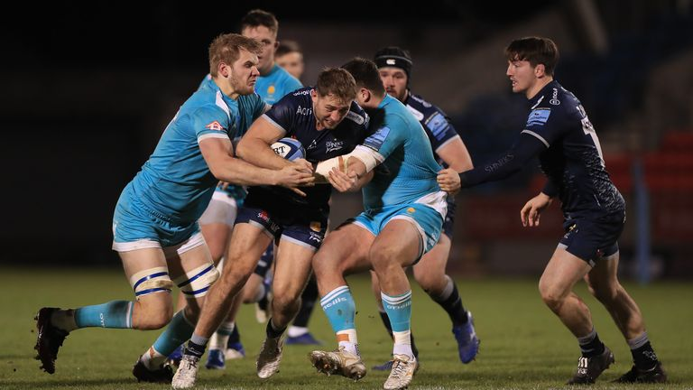 Sale's Sam Hill is wrapped up by the Worcester defence