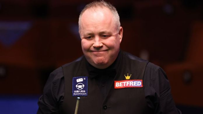John Higgins battled back from 7-4 down to defeat China's Tian Pengfei at the World Snooker Championship