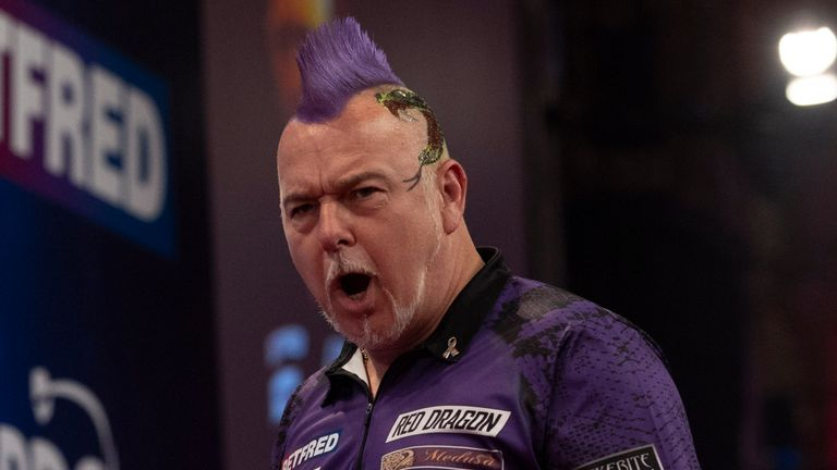 Peter Wright was at his sparkling best to knock out Michael van Gerwen (Image: Lawrence Lustig/PDC)