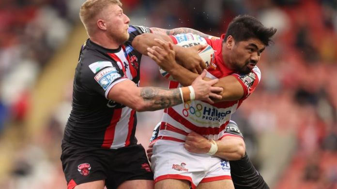 Leigh Centurions' James Bell in action with Salford Red Devils' Danny Addy