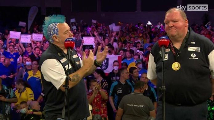 John Henderson and Peter Wright give their reactions after winning the World Cup.