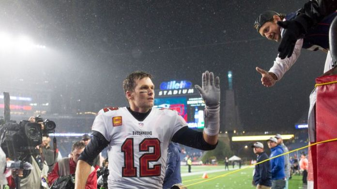 Tampa Bay Buccaneers' Tom Brady says it felt pretty cool to break the NFL's all-time leading passer record on his return to New England