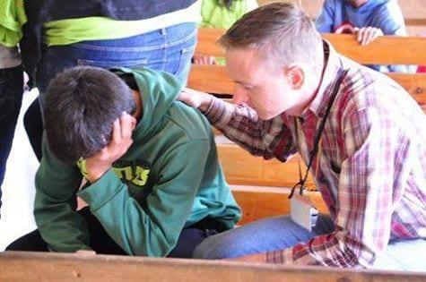 Tim leading prayer during Summer Camp