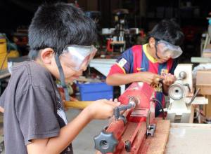 Woodworking on a pen lathe in an orphanage