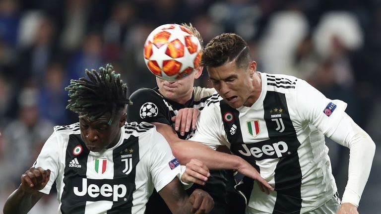 TOPSHOT - Juventus' Italian forward Moise Kean (L) and Juventus' Portuguese forward Cristiano Ronaldo go for a header during the UEFA Champions League quarter-final second leg football match Juventus vs Ajax Amsterdam on April 16, 2019 at the Juventus stadium in Turin. (Photo by Isabella BONOTTO / AFP)        (Photo credit should read ISABELLA BONOTTO/AFP via Getty Images)