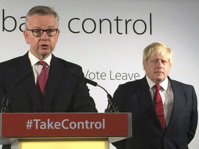 Britain's Justice Secretary Michael Gove speaks as head of the voting campaign to leave Boris Johnson listening to the group's headquarters in London