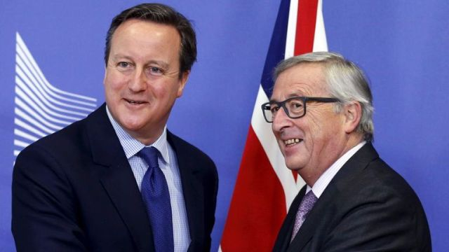 David Cameron poses with EU Commission President Jean-Claude Juncker in Brussels.
