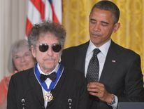 Barack Obama presents the Presidential Medal of Freedom to Bob Dylan  in 2012