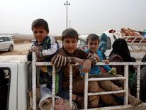 A displaced Iraqi family flees the IS controlled village of Abu Jarboa