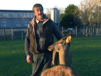 Farmer Kenny Gracey  with some of his animals