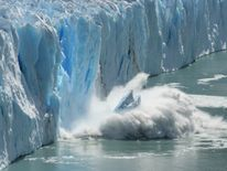 Ice collapses into the sea in the Arctic