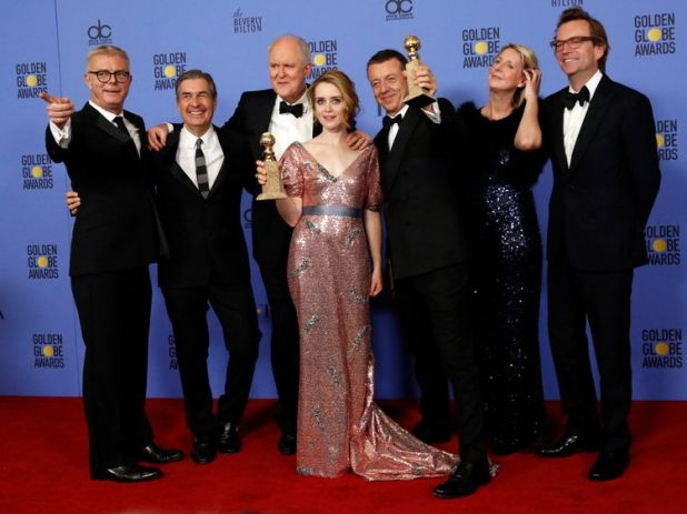 """The cast and crew of """"The Crown"""" pose together after winning the award for Best Television Series - Drama as star Claire Foy holds her award for Best Performance by an Actress In A Television Series - Drama during the 74th Annual Golden Globe Awards in Beverly Hills, California, U.S., January 8, 2017"""