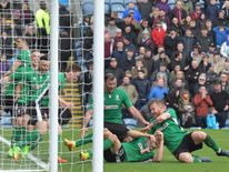 Sean Raggett is mobbed by his teammates after scoring