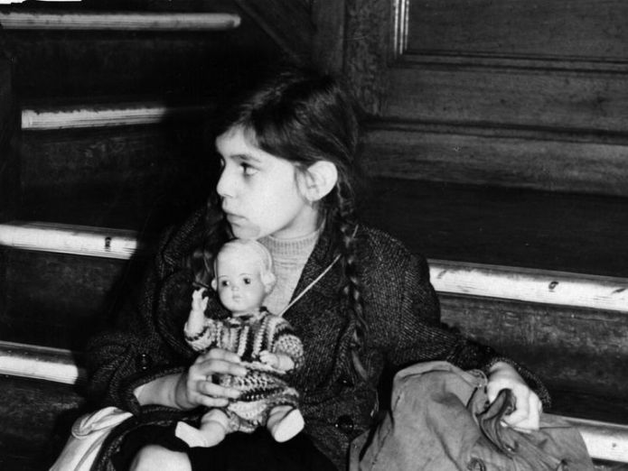 2nd December 1938: Tired and alone, 8-year-old Josepha Salmon, the first of 5,000 Jewish and non-Aryan refugees, known as the 'Kindertransport', arrives at Harwich from Germany, destined for Dovercourt Bay camp. (Photo by Fred Morley/Getty Images)