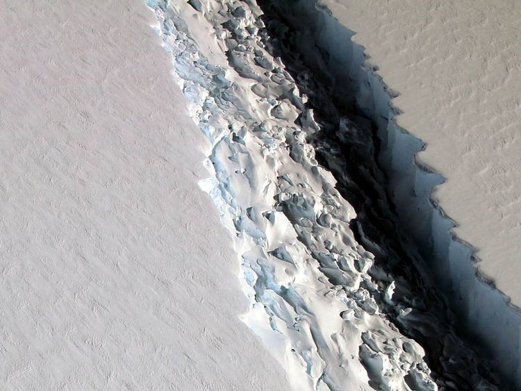 An oblique view of a massive rift in the Antarctic Peninsula's Larsen C ice shelf is shown in this November 10, 2016 photo taken by scientists on NASA's IceBridge mission in Antarctica. Courtesy John Sonntag/NASA/Handout via REUTERS