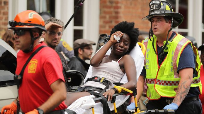 Rescue workers move victims on stretchers after car plowed through a crowd of counter-demonstrators  Donald Trump fuels Charlottesville flames with unapologetic remarks Donald Trump fuels Charlottesville flames with unapologetic remarks 4e96856731f61b9d0e40d2c0b0ae5d6320dc1eb85cef90a35ba86ea512bc4054 4072416