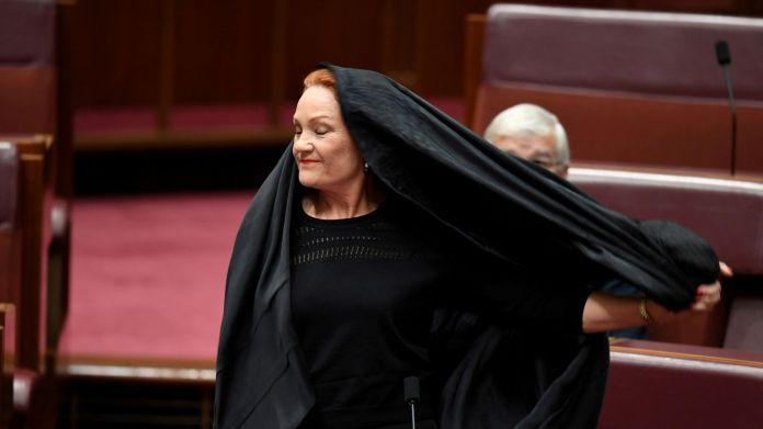 Australian One Nation party leader, Senator Pauline Hanson pulls off a burqa in the Senate chamber at Parliament House in Canberra Australian senator defends wearing burka in parliament after backlash Australian senator defends wearing burka in parliament after backlash b29f0f58b40367fbc55c4100738decdb7deb73ecd1d4f5019a281baf46993a48 4075643