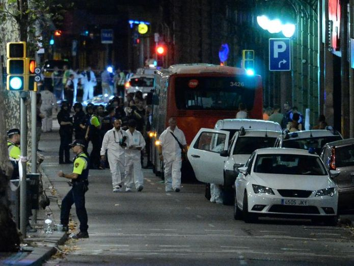Forensic police arrive at a cordoned area after a van struck people in Barcelona Barcelona terror attack suspects: Who are they? Barcelona terror attack suspects: Who are they? 1809a9af23a4afed4b1476150dd213414b18da15bbd9fff95f73a97aecabe14f 4076328