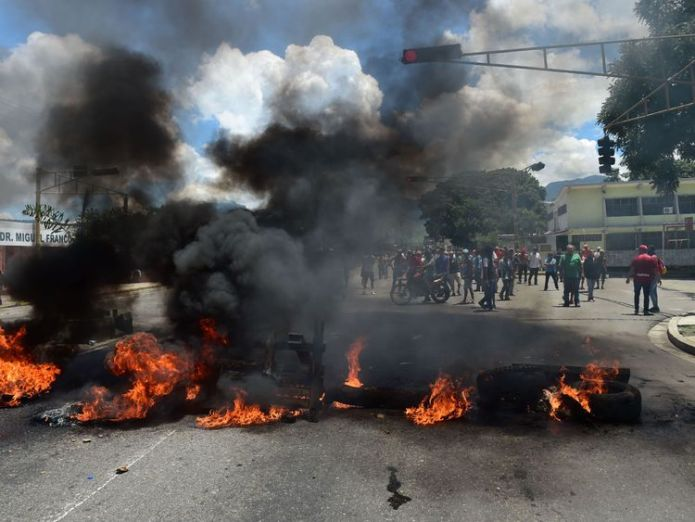 Protesters set a barricade on fire in Valencia, Venezuela's third-biggest city Trump considering 'possible military option' in Venezuela Trump considering 'possible military option' in Venezuela fe036f24cc053eadd233ecfbab432f082e845d8d481836f14b2a53c3f374aa2b 4067690
