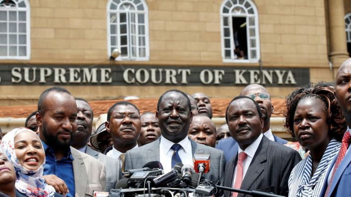 Opposition leader Raila Odinga (centre) hailed it as 'a precedent-setting ruling'