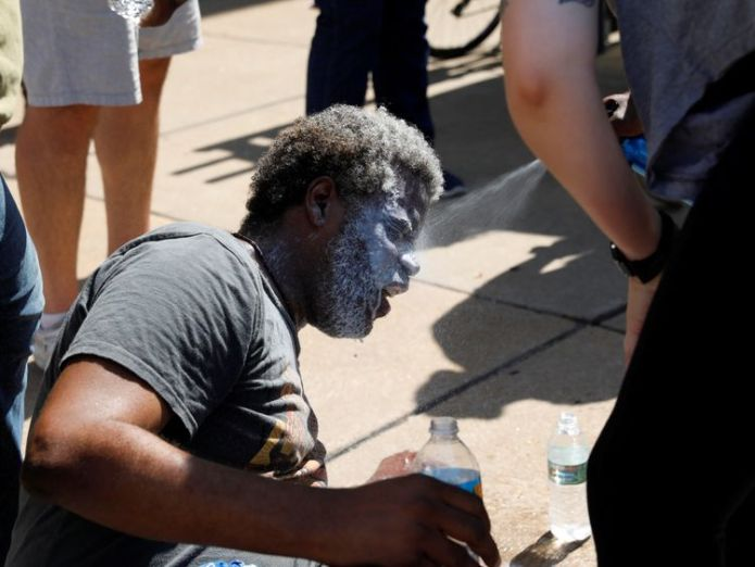 A protester is treated for pepper spray during the demonstration in St Louis