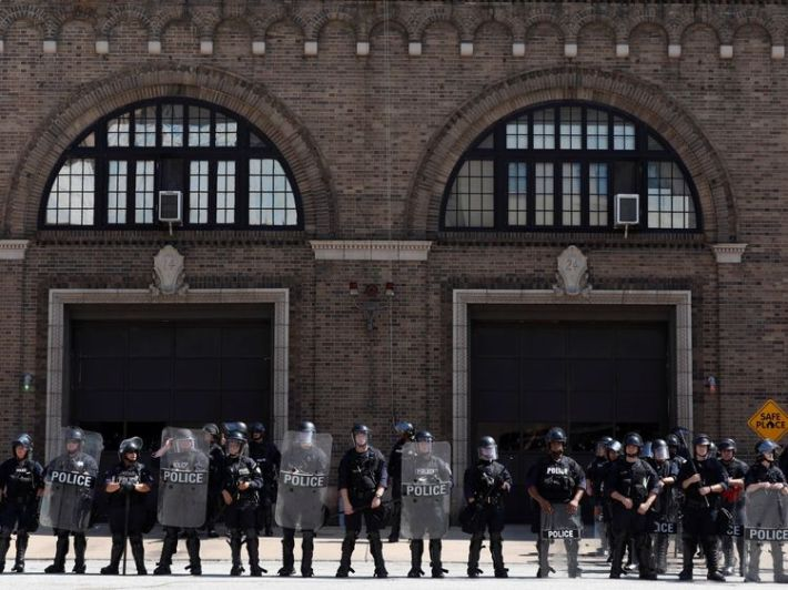 Police monitor the protesters in St Louis