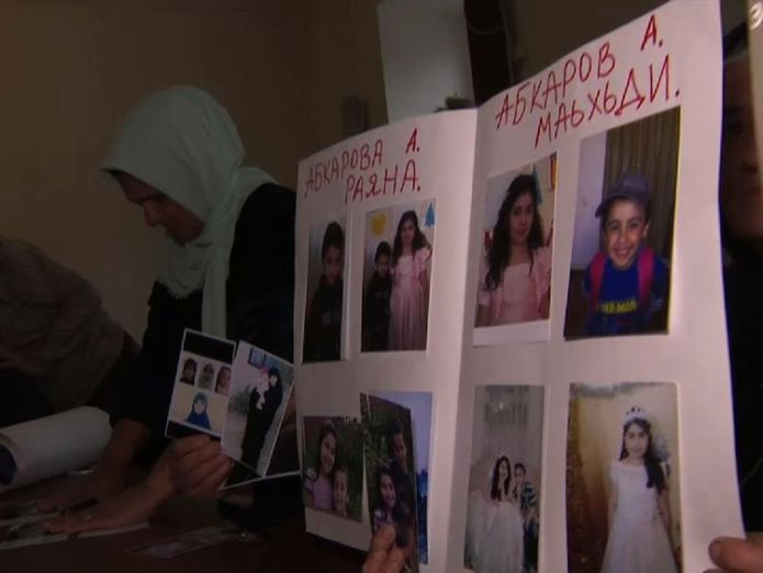 Chechen mothers hold photographs of their missing family after they married IS fighters Chechen mothers' agony over fate of Islamic State daughters Chechen mothers' agony over fate of Islamic State daughters skynews chechnya islamic state 4131473