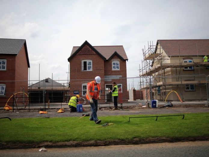 MIDDLEWICH, ENGLAND - MAY 20:  Construction workers build new houses on a housing development on May 20, 2014 in Middlewich, England. Official figures have shown that house prices have risen by 8% in the year ending in March. There have been calls by some experts for the UK Help to Buy scheme to scaled down as it boosts the property market.  (Photo by Christopher Furlong/Getty Images) Is Persimmon pay fury built on shaky foundations? Is Persimmon pay fury built on shaky foundations? skynews new house homes building 4135204