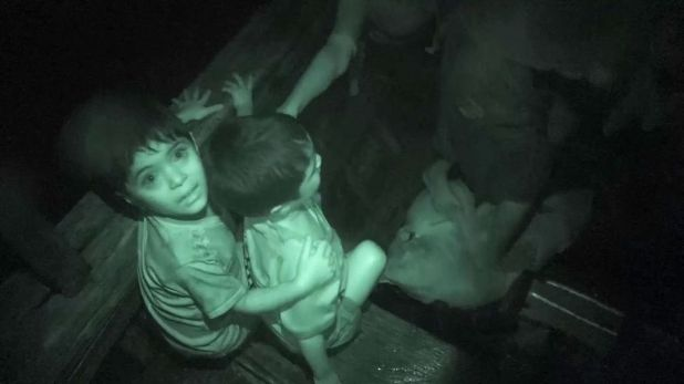 Rohingya children are packed on to a boat heading for Bangladesh