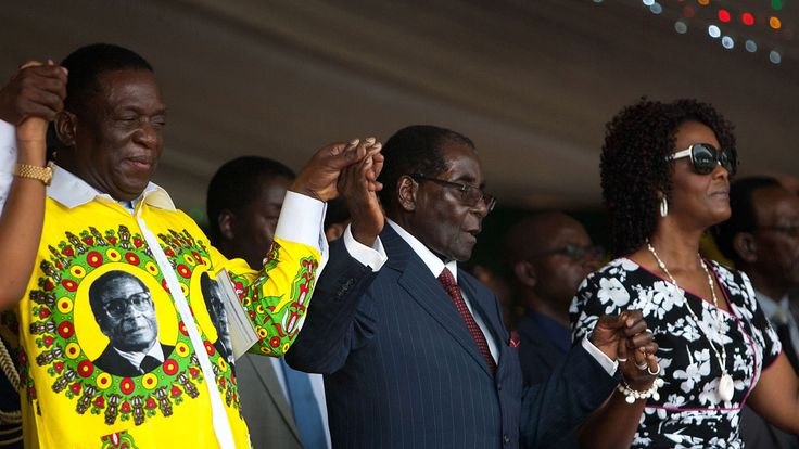 Mr Mnangagwa with Mr Mugabe (centre) and his wife Grace in 2016