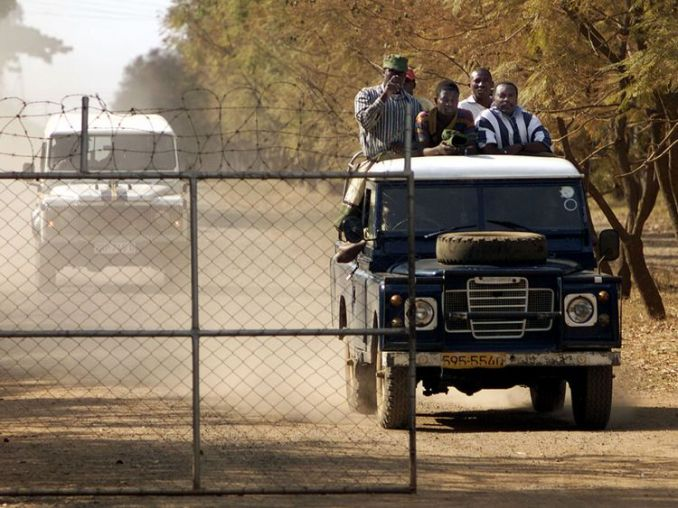 War veterans arrive to seize control of Parklands Farm, west of Harare, in 2000