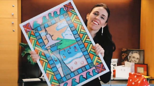 New Zealand Prime Minister Jacinda Ardern with her secret santa present