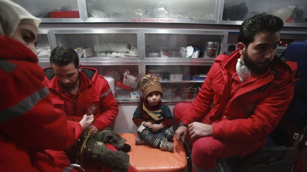 Syrian staff from the International Committee of the Red Cross take part in an evacuation operation in Douma in the eastern Ghouta