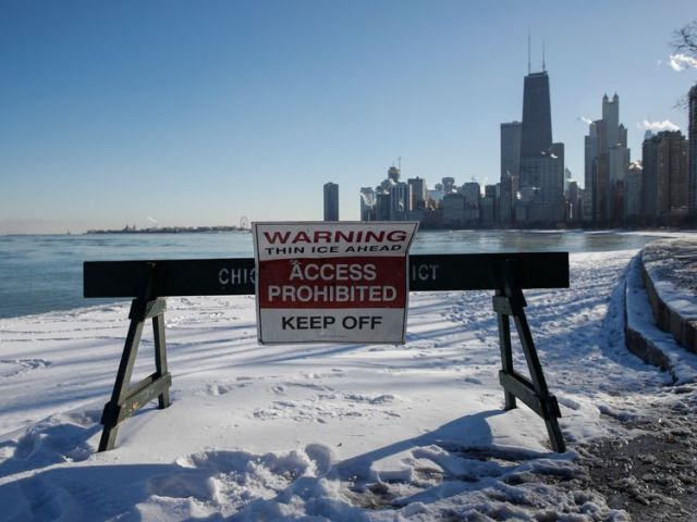 Pedestrians are warned away from the lakefront in Chicago, Illinois