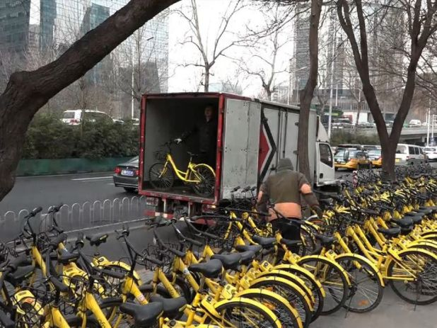 Rows of brightly coloured bicycles can be seen all over Beijing