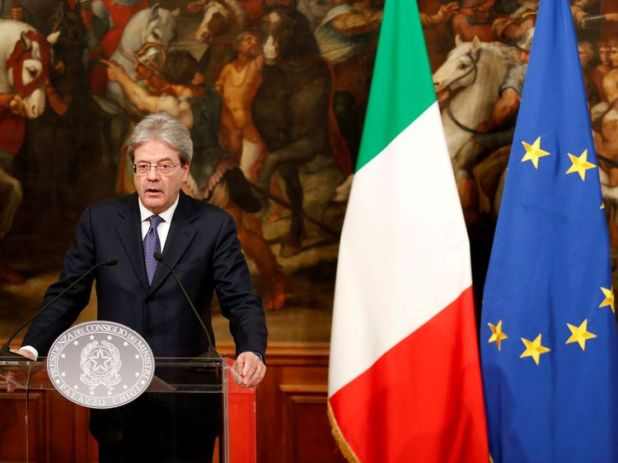 Italian Prime Minister Paolo Gentiloni attends a news conference 23 December