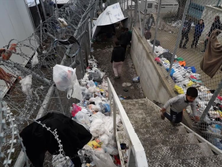Rubbish is piled high across the camp