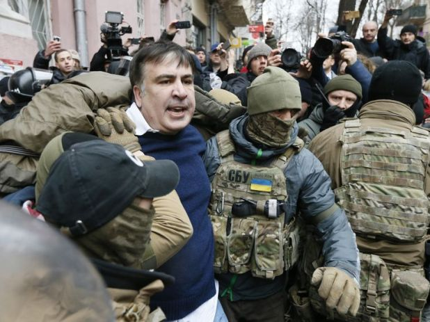 Former Georgian President Mikheil Saakashvili is detained by security officers in Ukraine.