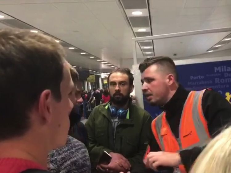 Ryanair passengers seek information at Stansted PIC: Sophia Sleigh