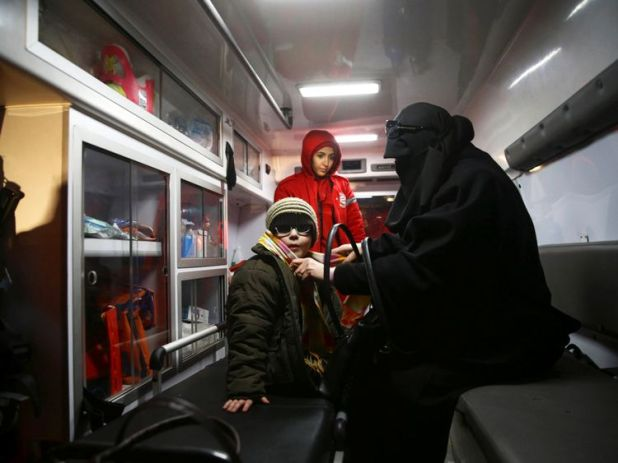 A woman with her child in an ambulance during medical evacuation from the besieged town of Douma, eastern Ghouta to Damascus