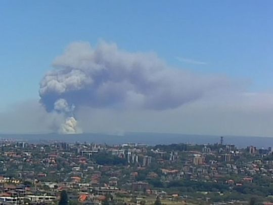 Thick black smoke could be seen billowing over the city