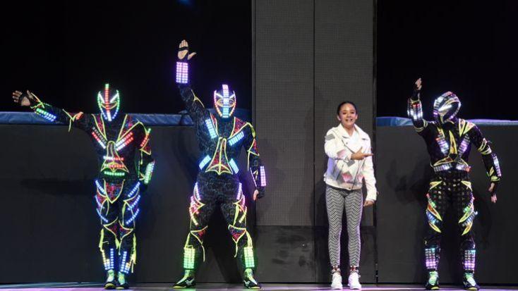 Members of Zero Gravity Arts wearing custom-engineered LED costumes perform before a keynote address by Intel CEO Brian Krzanich
