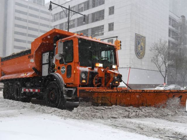 The winter storm has caused disruption to travel and the closure of schools in New York