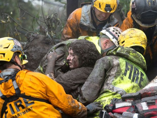 A woman is rescued from a collapsed house in Montecito. Pic: Santa Barbara News-Press