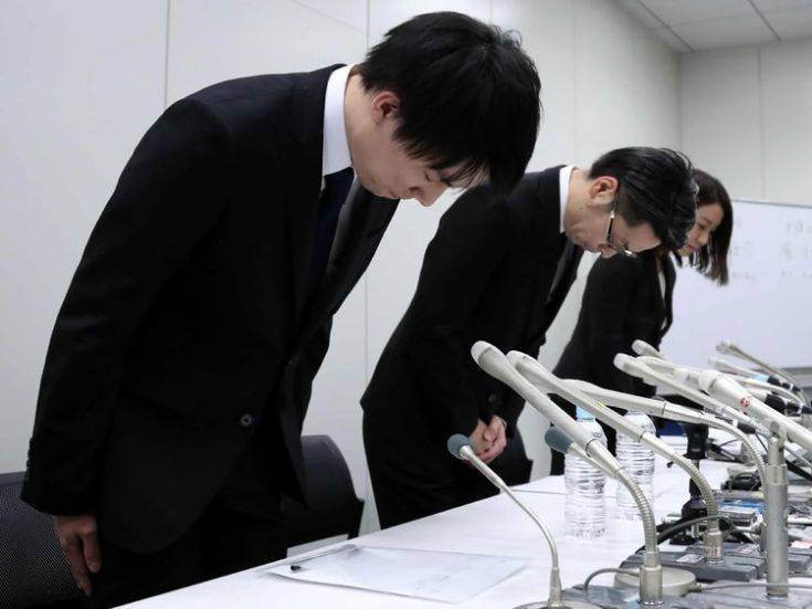 In this picture taken on late January 26, 2018, Coincheck president Koichiro Wada (L) bows in apology at the beginning of a press conference in Tokyo. Japan's government said on January 29 it would impose administrative measures on virtual currency exchange Coincheck after hackers stole hundreds of millions of dollars in digital assets from the Tokyo-based firm. / AFP PHOTO / JIJI PRESS / - / Japan OUT (Photo credit should read -/AFP/Getty Images)