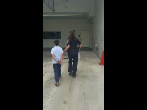 The child was led away from school in handcuffs