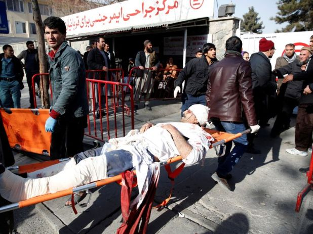 People carry an injured man to a hospital after a blast in Kabul, Afghanistan January 27, 2018