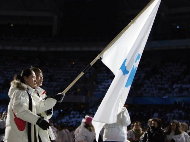 North and South Korean athletes holding the Unification Flag in 2006