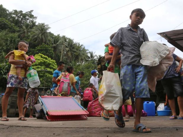 Residents with their belongings wait for a military truck to evacuate following an eruption from Mayon last week